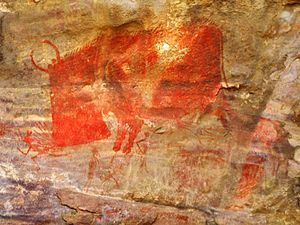 A man being hunted by a beast, Bhimbetka Cave paintings.jpg