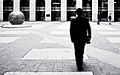 A man walks on the courtyard of the European Parliament (motion blur).jpg