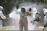 A member of the Marine Corps Air Station Beaufort fire department is washed as he goes through a decontamination center at the sight chemical spill at the training pool at Marine Corps Air Station Beaufort 130719-M-VR358-094.jpg