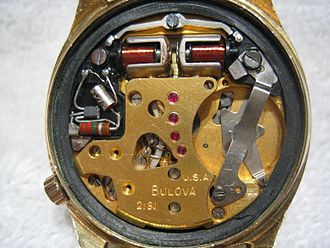 Bulova - Accutron Movement. The tuning fork prongs are around the two electromagnetic coils at the top of the watch, which  drive it.