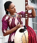 Aid for Trade Global Review 2017 – Day 1 Sona Jobarteh tuning kora.jpg