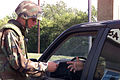 Airman Douglas Gilbertson, 55 Security Forces Squadron, Offutt Air Force Base, Nebraska, checks ID's on all incoming traffic on base, due to the threatcon Delta that was implemented on all bases 010911-F-XA417-002.jpg
