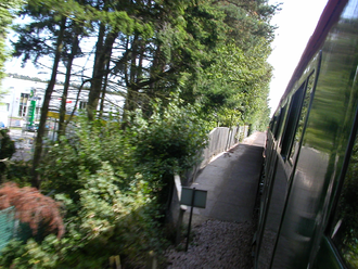 Lymington branch line - View of the remains of Ampress Halt from passing train, looking towards Lymington.