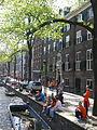 Amsterdam - Koninginnedag 2012 - People sunbathing on Oudezijds voorburgwal.JPG