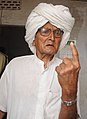 An old man showing mark of indelible ink after casting his vote, at a polling booth, during the 5th Phase of General Elections-2014, at Jaipur Rural Constituency, Rajasthan on April 17, 2014.jpg