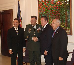 Kenneth McClintock - Kenneth McClintock greets BG. Hector E. Pagan in the presence of (L – R) House Speaker Jose F. Aponte and MG Felix Santoni (Ret.) in the State Capitol on Memorial Day 2008
