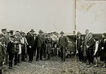 Arthur Butler and his Comper Swift aeroplane G-ABRE in field with crowd, 1931.jpg