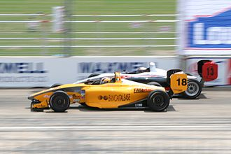 Atlantic Championship - Giacomo Ricci (foreground) passing Frankie Muniz in their Swift 016.a machines during the 2007 Houston race.