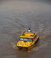 Australian Volunteer Coast Guard rescue boat on the flooded Brisbane River.jpg