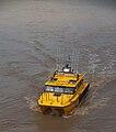 Australian Volunteer Coast Guard rescue boat on the flooded Brisbane River.jpg