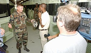 Clive Myrie - Myrie with the chief guard at Guantanamo Bay detention camp, 2004