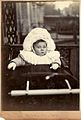 Baby John Hook in his pram, complete with mittens and hat, December 1907 (6637613577).jpg
