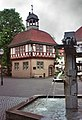 Bad Sooden-Allendorf, hlaf-timbered house and fountain.jpg
