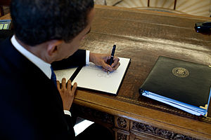 Energy policy of the Barack Obama administration - Barack Obama signs at his desk