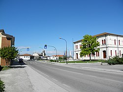 Via Oriano Scavazza and Town Hall in Baruchella.
