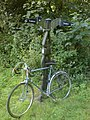Bike leaning against cycle path mile post - geograph.org.uk - 677925.jpg