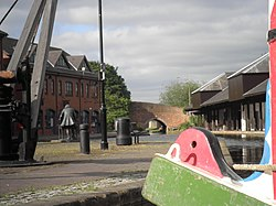 Bishop Street Basin, Coventry Canal with Bridge No 1 and James Brindley statue.jpg