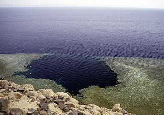 "Blue Hole (Red Sea) - Blue Hole seen from above. The area towards the sea is not ""The Arch"" but a shallow bank called ""The Saddle""."