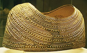 Welsh gold - The Mold Cape, solid sheet-gold, c. 1900–1600 BC, Bronze Age. It was found at Mold in Flintshire, Wales, in 1833