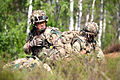 British soldiers relay information during a simulated attack as part of exercise Saber Strike 2013 in Adazi, Latvia, June 6, 2013 130606-O-ZZ999-006.jpg