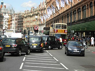 London congestion charge - Traffic congestion on the Brompton Road outside Harrods (part of the A4). This road was part of the extended congestion charge zone.