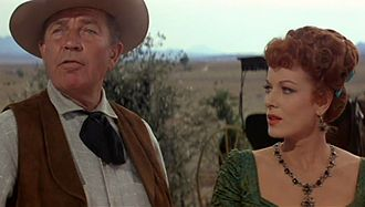 Bruce Cabot - Cabot and Maureen O'Hara in a scene from the film McLintock! (1963).