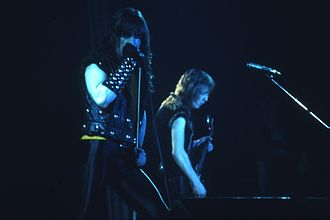 Bruce Dickinson - Bruce Dickinson, left, performing on his first world tour with Iron Maiden in 1982