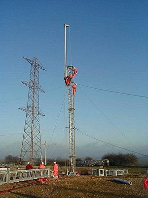 Eakring - Building pylons at Eakring Academy with National Grid plc in March 2004