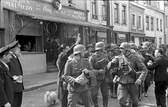 Eupen-Malmedy - German soldiers welcomed into Malmedy in May 1940 with swastika decoration and Nazi salute.