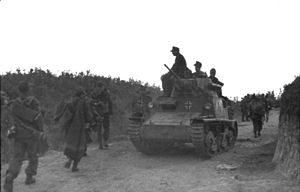 Fiat L6/40 - An L6/40 with German markings passes German infantrymen in occupied Albania, September 1943