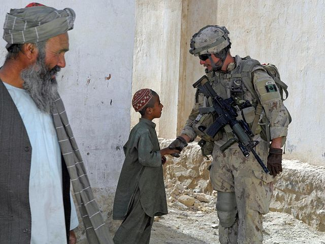 filecanadian soldier shakes hand with a kid in kandahar