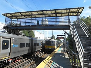 Carle Place (LIRR station) - An eastern Long Island-bound M3 leaves Carle Place station, while an M7 bound for NYC waits for passengers.