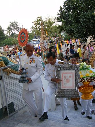 Ecclesiastical peerage of Thailand - A monk parades his letter of appointment and fan of rank throughout the town of Uttaradit.