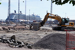 Jätkäsaari - A construction site in Jätkäsaari. The 315 m long M/S Celebrity Eclipse is seen in the background.