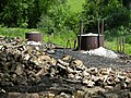 Charcoal burning at Heligan - geograph.org.uk - 699742.jpg