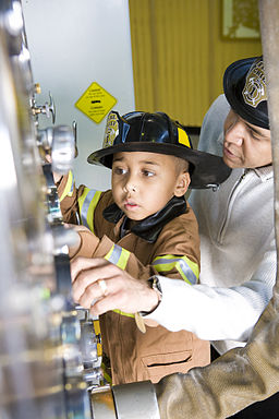Child exploring simulated fire station (Children's Museum of Denver, 2009)