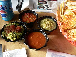 Chips, guacamole, three salsas.jpg