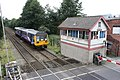 Class 142 train and Shaw Station Signal Box - geograph.org.uk - 1499197.jpg