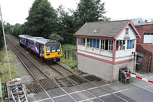 Oldham and Rochdale Line - Image: Class 142 train and Shaw Station Signal Box geograph.org.uk 1499197