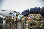 Coalition personnel depart on last camber flight at TCM 140221-F-VU439-099.jpg