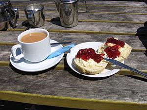 Tea (meal) - Devon cream tea, comprising tea taken with scones, clotted cream and jam
