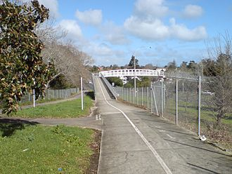"Northwestern Cycleway - The cycle overbridge over Great North Road, near Point Chevalier. Opened in 2004 as the (then) last major piece of the Northwestern Cycleway, it later won ""Best cycle facility project"" in the 2004 CAN Cycle Friendly Awards."