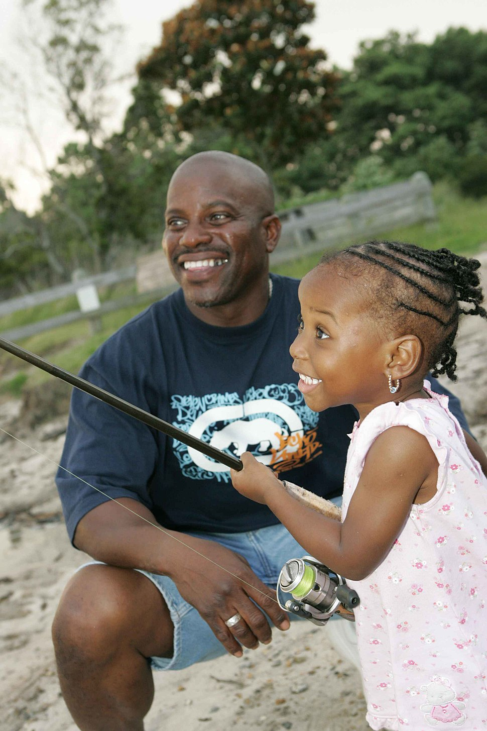 Dad and daughter fishing young girl learns to fish