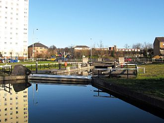 Forth and Clyde Canal - The unique Drop Lock at Dalmuir takes boats below a fixed bridge.