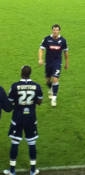 Dany N'Guessan - N'Guessan (bottom) about to come on as a substitute for Millwall.