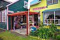 Day trip from Puerto Varas to Isla Grande de Chiloe - in and around Chacao, Chile - rather colourful artisans buildings - (24554245054).jpg