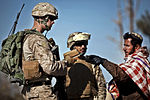 Defense.gov News Photo 111212-M-MM918-003 - U.S. Marine Sgt. Matt Garst speaks with a local man about irrigation during a security patrol near a canal from which Marines previously helped.jpg
