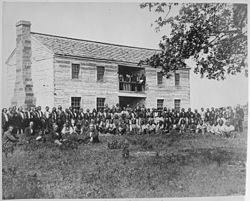 Delegates from 34 tribes in front of Creek Council House, Indian Territory, 1880 - NARA - 519141.jpg