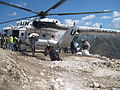 Delivering food by helicopter for WFP after the Haiti earthquake, March 2010 (8406368972).jpg