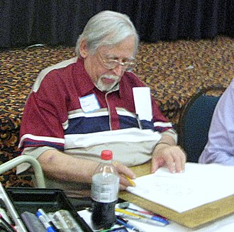 Dick Giordano - Giordano signing at a comic convention, August 2008.